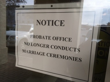 A sign posted at the front door of the Baldwin County Probate Office in Bay Minette, Ala., indicates that marriages of any kind will not be performed at the office. (John Sharp/jsharp@al.com).