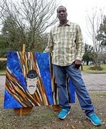 Shun Q. Thomas created a painting depicting an image he saw in a tree in 2006. (Mike Brantley/AL.com).
