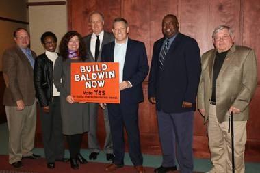 Posing with Baldwin County school Superintendent Robbie Owen, center, are Bay Minette City Council members John Biggs, Dollie Mims, Kathy Dobbins, Mayor Bob Wills, Chris Norman and Danleigh Corbett. (Courtesy Bob Wills)