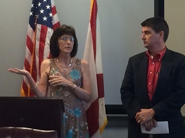 Sandra Dunaway, co-chairwoman of the Bank On South Alabama steering committee, stands next to Baldwin County Commissioner Tucker Dorsey on Friday, Aug. 28, 2015, during a news conference announcing the new banking program in Fairhope, Ala. (John Sharp/jsharp@al.com).