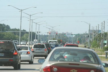 Memorial Day weekend traffic heads southbound on Ala. 59 on Sunday, May 25, 2014, in Gulf Shores, Ala. Coastal Alabama continues to see a surge in summer visitors stressing the area's infrastructure and creating gridlock on state highways and city and county roads. (file photo)