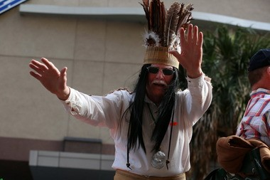 Wayne Dean Sr., dressed as Cain's Indian chief character, Slacabamarinico, leads the foot marchers in the annual Joe Cain Day Procession in downtown Mobile, Ala., on Sunday Feb. 15, 2015. (Sharon Steinmann/ssteinmann@al.com)