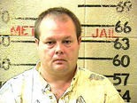 A mugshot of Thomas Lane, taken as he was booked and charged for the murder of his estranged wife Theresa Lane on October 13, 2003.