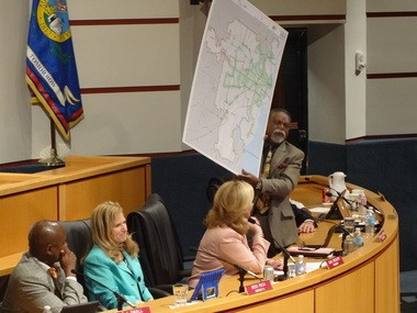 Mobile City Council member Fred Richardson holds up a map illustrating the coverage that The WAVE bus service provides in Mobile, during the council's meeting on Tuesday, April 12, 2016. The map was brought into the discussion by the city's Executive Director of Finance, Paul Wesch. (Lawrence Specker/LSpecker@AL.com)