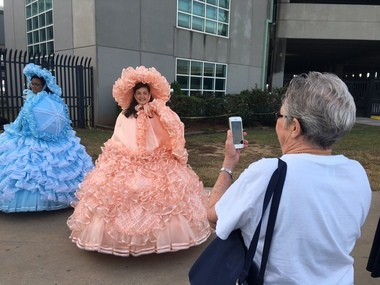A passenger aboard the Azamara Quest cruise vessel takes a picture with her cell phone of the Azalea Trial Maids on Monday, Oct. 24, 2016, in Mobile Ala. (John Sharp/jsharp@al.com).