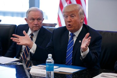 Sen. Jeff Sessions, R-Ala., left, looks on as Republican presidential candidate Donald Trump speaks during a national security meeting with advisors at Trump Tower, Friday, Oct. 7, 2016, in New York. (AP Photo/ Evan Vucci)