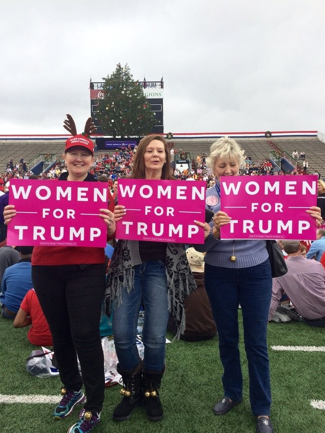 """""""Women for Trump"""" signs are fairly common in the crowd at President-elect Donald Trump's appearance Saturday, Dec. 17, in Mobile. Shown: Ruth Hebert, 77, from Baton Rouge, Louisiana (far right) and her daughters, Karen Blackburn, 51, of Mobile, (left side), and Pamela Linccum, 56, Baton Rouge, Louisiana (middle). (Prescotte Stokes/PStokes@AL.com)"""