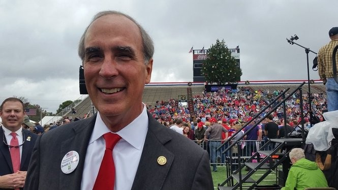 """""""This is awesome,"""" Mobile Mayor Sandy Stimpson said of President-elect Donald J. Trump's return visit to Mobile. Shown, from left: Stimpson's chief of staff, Colby Cooper; Stimpson; and a certain tree provided by the city for the event. (Lawrence Specker/LSpecker@AL.com)"""