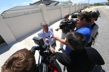 State Auditor Jim Zeigler speaks to reporters outside the gubernatorial beach house on the Fort Morgan peninsula. (Brian Kelly/bkelly@al.com)