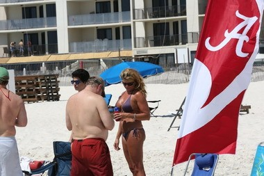 Spring Break visitors to Gulf Shores, Ala., display their allegiance to the University of Alabama Crimson Tide.