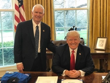 U.S. Rep. Mo Brooks, R-Huntsville, poses with President Donald Trump (file photo)