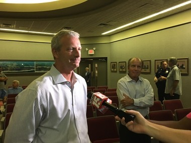 Gulf Shores City Councilman Jason Dyken speaks to the local media on Monday, July 31, 2017, after the Gulf Shores City Council voted unanimously to move forward with a study on the costs of an independent city school. Standing in the background is Gulf Shores Mayor Robert Craft. (John Sharp/jsharp@al.com).