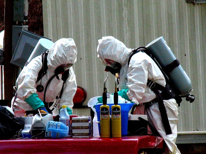 Aside from a risk of fires and explosions, home-brew meth labs were known for leaving toxic byproducts that endangered bystanders and investigators. In this 2005 photo, investigators with the Alabama Department of Forensic Sciences office in Mobile examine chemicals taken during a meth raid. (Ron Colquitt/Press-Register File)