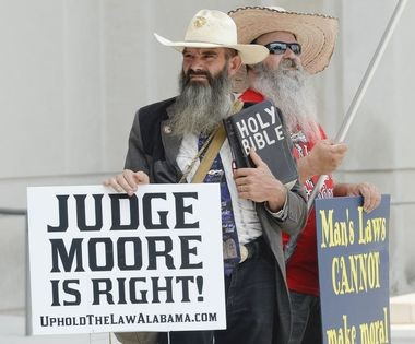 Evangelist Alan Hoyle, left, and Johnny Brekeen of Jayess, Miss., show support for Alabama Chief Justice Roy Moore Monday, Aug. 8, 2016, as Moore supporters of gather outside the Alabama Judicial Building in Montgomery, Ala., before his misconduct hearing. (Julie Bennett/jbennett@al.com)