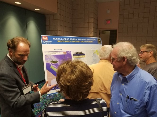 Dauphin Island homeowner Stan Graves, right, listens as Corps of Engineers Project Manager David Newell, left, talks about possibilities for the placement of dredge spoil from a project to enlarge the Mobile Ship Channel. (Lawrence Specker/LSpecker@AL.com)