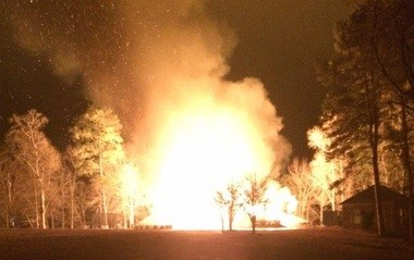 This photo provided to AL.com shows a home owned by former Alabama football player Rolando McClain engulfed in flames Monday night, Dec. 22, 2014. (Special to AL.com)