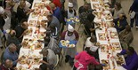 Volunteers serve hungry people Thanksgiving dinner at a Salvation Army kitchen in Mobile, Ala., in 2012. People who are hungry tend to be more supportive of programs that help the poor, recent study shows. (Bill Starling / BStarling@AL.com)
