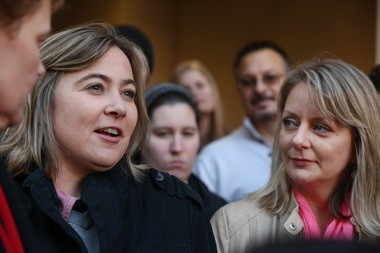 Cari Searcy, left, and Kim McKeand, plaintiffs in the case that struck down Alabama's same-sex marriage ban, hold a press conference with their lawyers in front of the Mobile County Marriage License Office at Probate Court in Mobile, Ala., on Monday Jan. 26, 2015. (AP Photo/AL.com, Sharon Steinmann)
