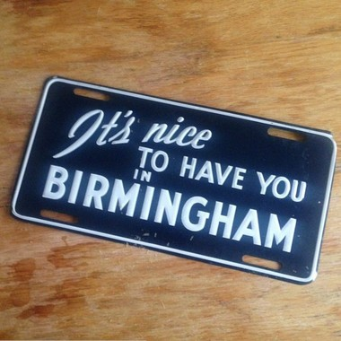 """A license plate from the original campaign. """"It's Nice to Have You in Birmingham"""" is nothing new in Birmingham."""