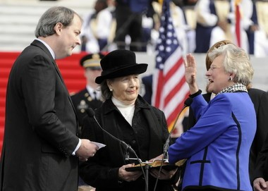 Balch & Bingham lawyer Will Sellers swearing now-Gov. Kay Ivey in as lieutenant governor in 2011. (Joe Songer)