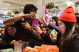 """People shop at Macy's on """"Black Friday"""" in 2017."""