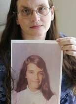 A victim with a photo of her as a youth.