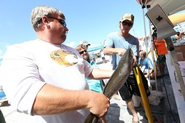 Terry Pratt of Mississippi hauls in a speckled trout at just over 8 pounds. Anglers weigh-in their catch around 3:15 p.m. at the Flora-Bama Yacht Club in Perdido Key, Fla. during the 2nd annual Flora-Bama Fishing Rodeo on Saturday, June 26, 2015, the second day of the three-day tournament. The tournament continues through Sunday afternoon. (Brian Kelly/bkelly@al.com)