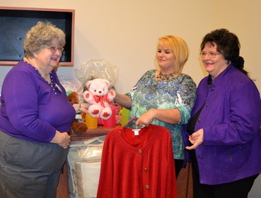Port City Craftsmen recently donated clothing, linens, housewares and toys to All God's Children, a non-profit organization whose focus is on families, women and children. From left are Louise Powell, longtime PCC member; Sonya Humphries, director of AGC; and Ginger McCracken, PCC philanthropy chair. (Jo Anne McKnight / Press-Register Correspondent)