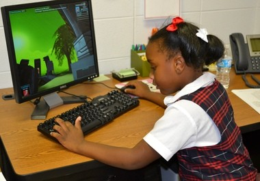 Prichard Preparatory School consistently scores at the top of DimensionU Leaderboard, in the state and nation. PPS students are becoming proficient in math after joining this program, said Principal Rosalie Howley. Ferrin Westry, a first-grader in Ashley Guy's classroom, shows how it's done. (Courtesy of Rosalie Howley)