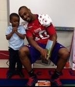 On Jan. 24, LSU wide receiver Russell Shepard visited Grant Elementary School. He is shown with Jordan Hutchins. (Courtesy of Grant Elementary School)