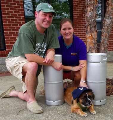 Brian Kane and wife, Michele, pose with a couple of kegs and their rescue dog, Barkley, who is ready to greet everyone at the April 18 event for The Haven. (Submitted by Kathie Ono)
