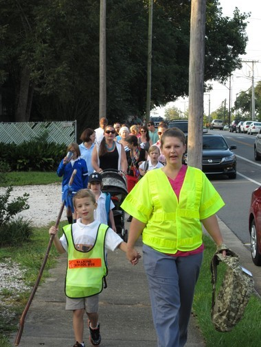 Cooper Davis, a Fairhope Elementary first-grader, and his mother Dottie Davis lead the Pirate Parade Smart Walk that took place on Friday, Sept. 6. Cooper will be one of the many students who will be participating in the daily Walking School Bus. (Courtesy of Charlene Lee)