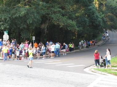Fairhope Elementary teacher Cathy Hudon assists with traffic during the kick off walk. Hudon will be one of the Fairhope Elementary teachers who will walk with students along the eight-tenths of a mile route as part of the pilot daily Walking School Bus. (Courtesy of Charlene Lee)