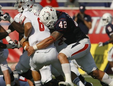 South Alabama linebacker Jake Johnson gets the Jags' first sack of the season against Nicholls State in a Sept. 8, 2012 game at Ladd-Peebles Stadium. Johnson was the Jags' and Sun Belt's leading tackler this season. (Photo by Mike Kittrell)