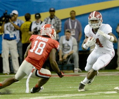 Alabama running back T.J. Yeldon of Daphne sidesteps Georgia safety Bacarri Rambo during the SEC championship game on Dec. 1, 2012, at the Georgia Dome in Atlanta, Ga. Yeldon is the first freshman at Alabama to reach 1,000 rushing yards. (Julie Bennett/jbennett@ al.com)