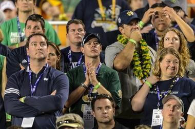 Notre Dame fans react during the third quarter of the BCS national championship game Monday night at Sun Life Stadium in Miami Gardens, Fla. (Vasha Hunt/vhunt@al.com)