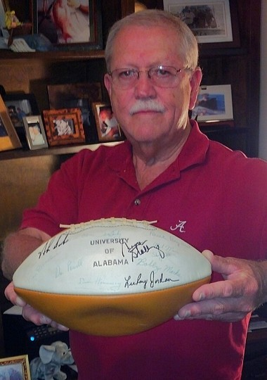 Perry Hartley of Fairhope holds his football that is full of Alabama football autographs, including those of coaches Paul 'AABear' Bryant, Gene Stallings and Nick Saban. (Mark Inabinett/minabinett@al.com)