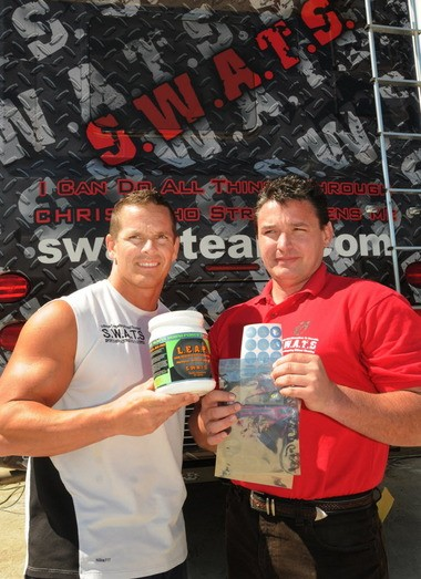 File: S.W.A.T.S owner Mitch Ross (left) and employee Christopher Keys hold some of the products they sell to athletes at Alabama, Auburn and UAB March 11, 2011 in Fultondale, Al. .(Birmingham News Photo Linda Stelter)