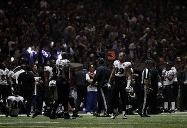Baltimore Ravens players look around the Superdome after the lights went out during the second half of NFL Super Bowl XLVII football game Sunday in New Orleans. (AP Photo/Matt Slocum)