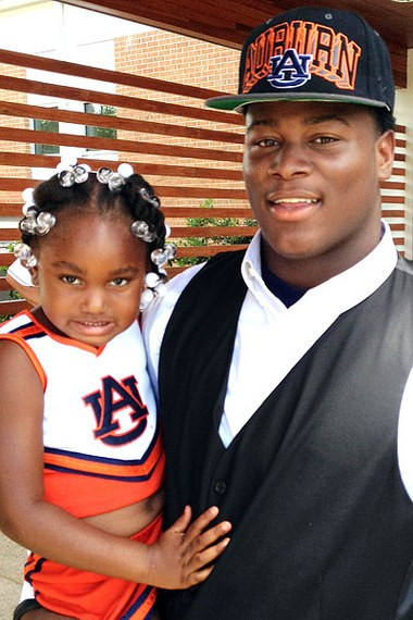 Reuben Foster and his daughter after announcing his commitment to Auburn on July. 12, 2012. (ESPN.com photo)