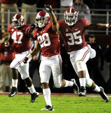 Alabama defensive back Dee Milliner (28) and linebacker Nico Johnson (35) celebrate after Milliner blocked a Mississippi State field-goal attempt Oct. 27. Both have been invited to the NFL Combine. (Mark Almond/ malmond@al.com)