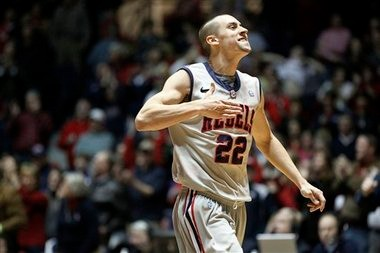 Mississippi guard Marshall Henderson (22) slaps his chest as his team takes the lead in overtime in their NCAA college basketball game against Georgia in Oxford, Miss., Saturday, Feb. 16, 2013. Mississippi won 84-74. (AP Photo/Rogelio V. Solis)