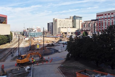 Workers begin to clear the site for the new College Football Hall of Fame in downtown Atlanta Monday, Feb. 18, 2013.