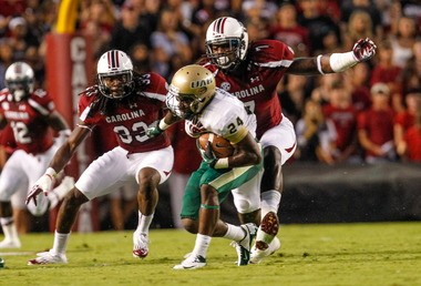 UAB's Greg Franklin (24) can't escape South Carolina's Jadeveon Clowney in a game last season. (The State).