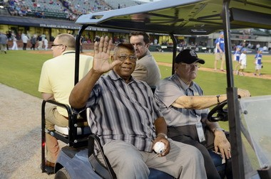 Hank Aaron takes a turn around Hank Aaron Stadium before throwing out the first pitch for the Mobile BayBears' Southern League game against the Huntsville Stars on July 13, 2012, in Mobile, Ala. (Press-Register file)