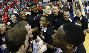Kerron Johnson (center) and Belmont teammates celebrate Ohio Valley Conference championship (The Associated Press)
