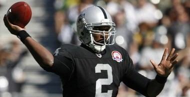 Quarterback JaMarcus Russell throws a pass while playing for the Oakland Raiders against the New York Jets during an NFL game in Oakland, Calif., on Oct. 25, 2009. (AP Photo)