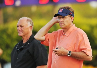 Mike DuBose, left, then working as defensive line coach at Memphis, watches a spring football game at Daphne High in 2011 with Auburn's Gus Malzahn. (Jon Hauge/al.com)