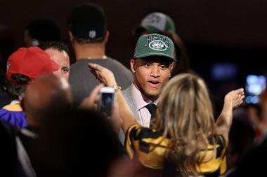 Dee Milliner, from Alabama, walks off the stage after being selected ninth overall by the New York Jets in the first round of the NFL football draft, Thursday, April 25, 2013, at Radio City Music Hall in New York.(AP Photo/Gregory Payan)