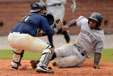 Huntsville Stars right fielder Kentrail Davis tries to slide past Mobile BayBears catcher Rossmel Perez to score during a Southern League game at Hank Aaron Stadium in Mobile on July 24, 2012. (Press-Register file)